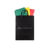 Black gloss adoption gift bag with green, yellow and red tissue paper, ready for Ethiopia adoption gifts