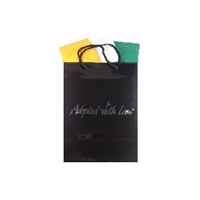 Black gloss adoption gift bag with green, white and goldenrod tissue paper, ready for India adoption gifts