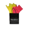 Black gloss adoption gift bag with red and yellow tissue paper, ready for Kyrgyzstan adoption gifts